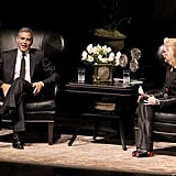 George Clooney and Lynn Wyattyou sat in large black chairs for an interview segment in Houston.