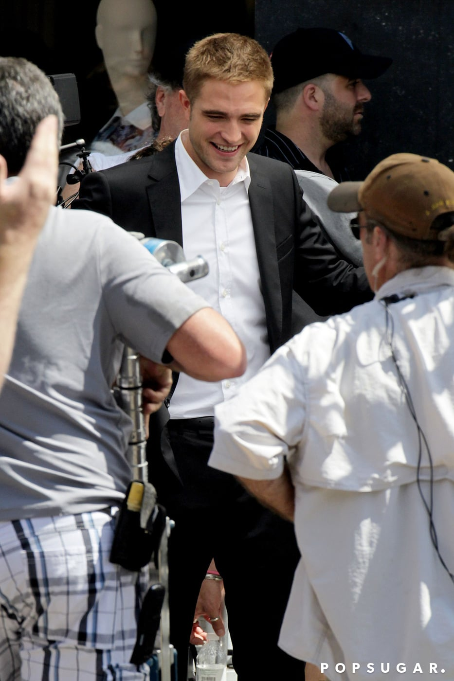 Robert Pattinson wore a suit to film scenes on Rodeo Drive.