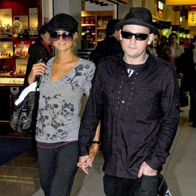 Paris Hilton and Benji Madden at Heathrow Airport in London