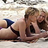 Naomi Watts and Robin Wright in swimsuits.