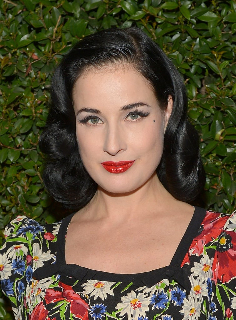 Of course, Dita Von Teese stuck with her usual formula of cherry-red lips, cat eyeliner, and vintage waves for the MAC and Vogue dinner.