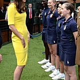 Kate held the attention of a group of ball boys and girls at Wimbledon in July 2016.