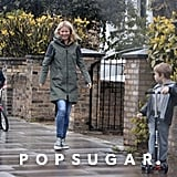 Gwyneth Paltrow walked in London with kids Apple Martin and Moses Martin after school.