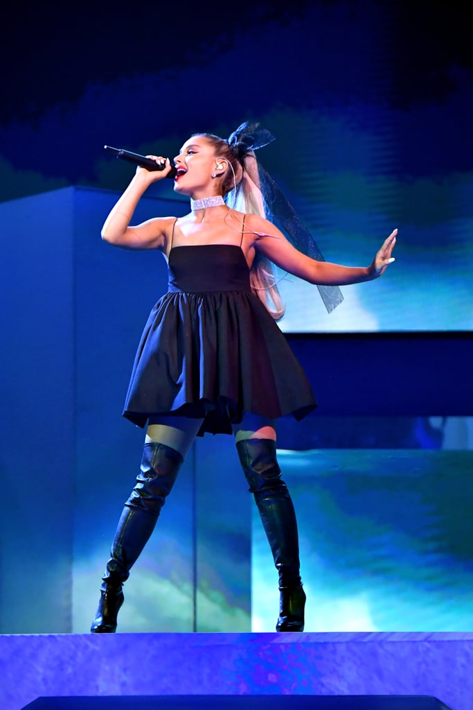 "Ariana Grande opened the Billboard Music Awards with a performance of ""No Tears Left to Cry"" straight out of a dream. The singer rocked a black minidress with thigh-high boots, but it was her hair that had us in a trance. Ariana accessorized her platinum blonde ponytail with an oversize black hair bow that went all the way down her back. Is Ariana making a case for hair bows to become the new It accessory? We have a feeling the answer might be yes, especially because she rocked a very similar gold bow at the Met Gala. That wasn't the only thing the 24-year-old switched up about her look — Ariana ditched her signature nude lip for a pop of red. Overall, it worked like a charm!      Related:                                                                                                           Ariana Grande's Huge Hair Bow at the Met Gala Is a Gift to Us All"