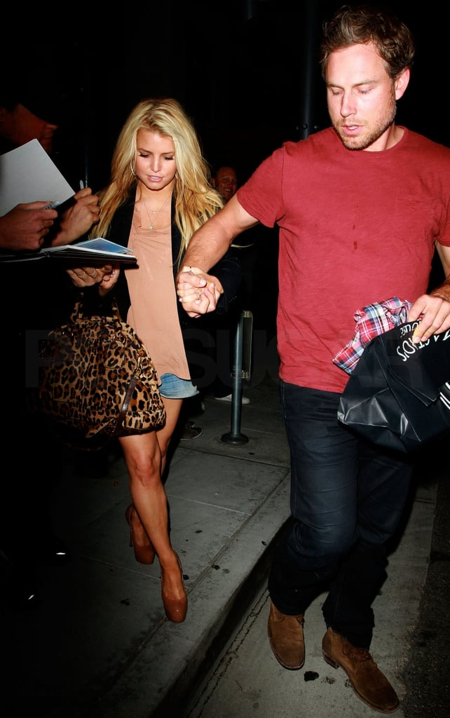 Jessica Simpson and her fiancé Eric Johnson stuck together Saturday for a dinner in LA. They headed out to their car after the meal at Maestro's Steakhouse, with Eric leading the way. The duo are in California together after Jessica took a quick trip to Chicago, where she apparently ate at the Paris Club and somehow ran into both Johnny Depp and Lady Gaga. Despite the traveling to support her Jessica Simpson collection, the newly minted Style Icon is also planning for her upcoming wedding. She and Eric have set a date for their big day, but Jessica apparently isn't planning to do any big bridal diet before walking down the aisle.
