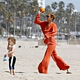Nicole Richie wore an orange jumpsuit as she tossed the ball with Sparrow.