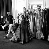 A model poses during fittings for Rami Al Ali
