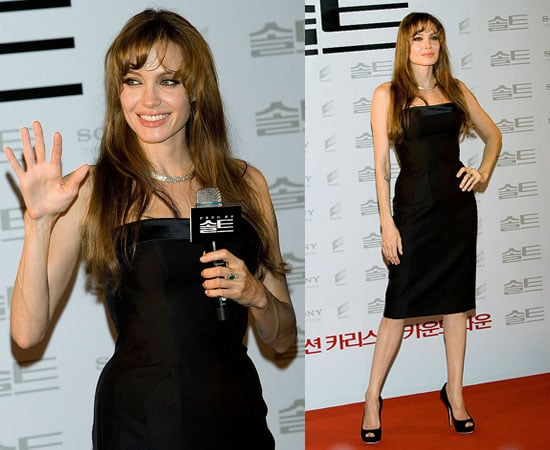 Pictures of Angelina Jolie at the Seoul Premiere of Salt, Andrew Morton's Angelina Biography Claims Rebel Due to Abondonment