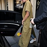 Later, Kendall showed off a distresed robe style with oversize pockets, letting it stand out by opting for denim and a white tee. She finished her outfit with her go-to sneakers and a Givenchy bag.