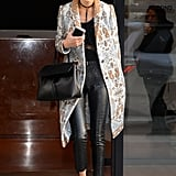Gigi Hadid knew her Tory Burch coat was the best printed piece to step up her black ensemble.