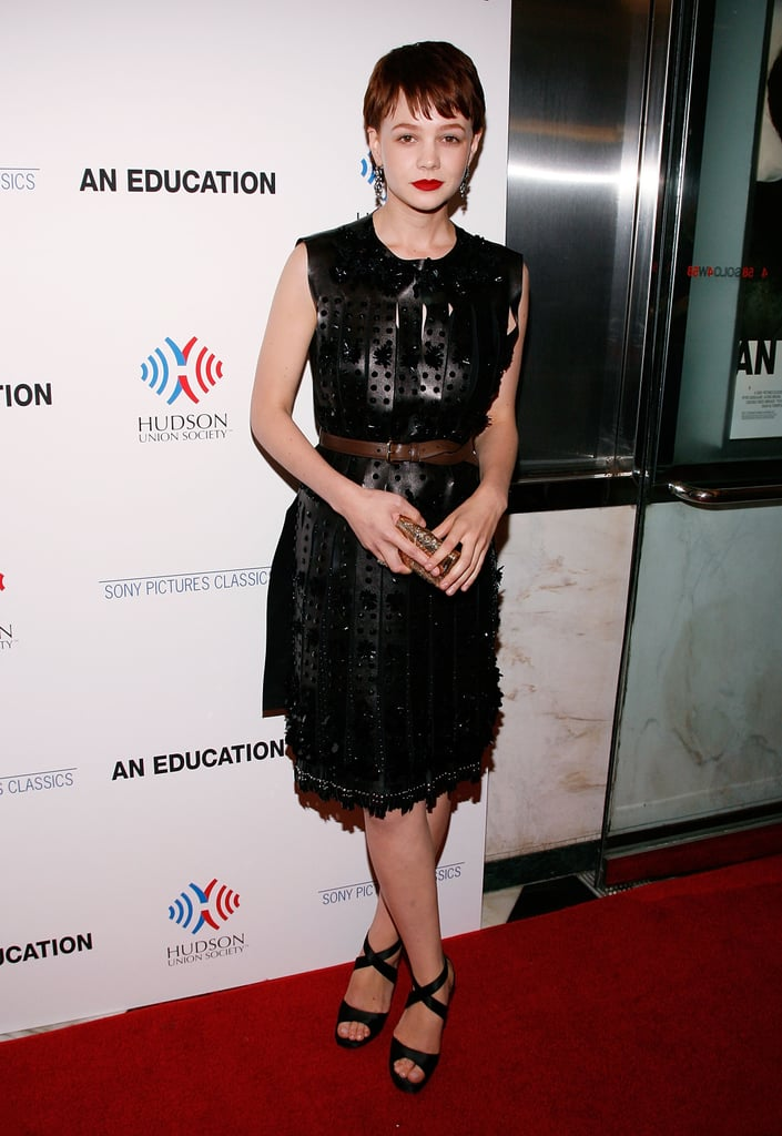 Donning a gladiator-inspired perforated-leather Prada confection, Carey toed the goth-glam line at the NYC premiere of An Education. She cinched her warrior-princess look with a brown leather belt to accentuate her fit frame, while ankle-strap sandals and an engraved clutch rounded out her party style.