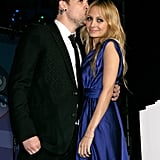 Joel Madden planted a kiss on Nicole Richie at the November 2008 UNICEF tree lighting in Beverly Hills.