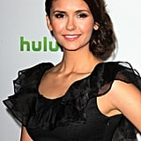 Nina Dobrev wore a side bun.