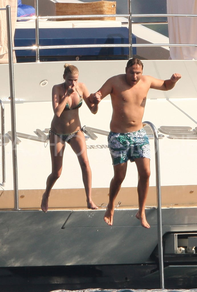 >> Lara Stone and her husband of just over a year David Walliams — who were first spotted leaving Club 55 in Saint Tropez a couple of days ago — have taken to the water on a yacht off the French coast. Stone, wearing a Missoni zigzag bikini, took hands with Walliams to jump off the boat's edge several times, before returning to land in a slate blue minidress.