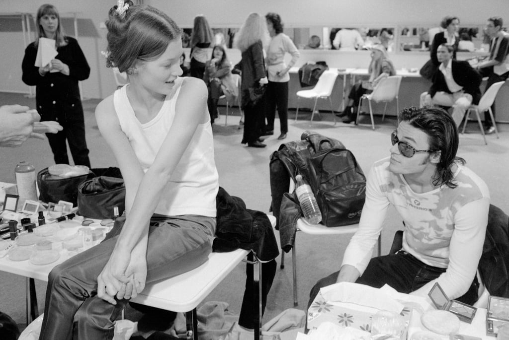 Backstage at Paris Fashion Week in 1991, wearing jeans and a white top.