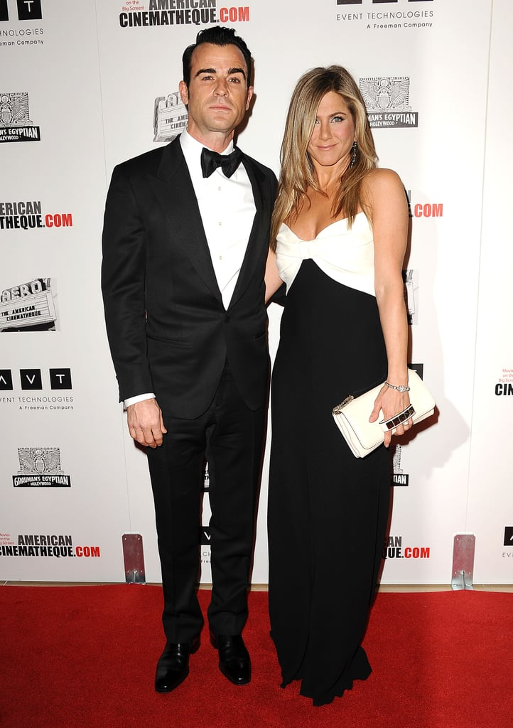 Jennifer Aniston and Justin Theroux posed for photos side by side last night at the Beverly Hilton Hotel, where they attended the 26th Annual American Cinematheque Awards. The big honoree of the evening was Ben Stiller, a close friend of both Jen and Justin. Jen worked with Ben on Along Came Polly and Justin's best-known collaboration with Ben is Tropic Thunder. Ben and his wife, Christine Taylor, spent plenty of time with Jen and Justin. The two couples were in Hawaii last Summer for a joint vacation in honor of Christine's 40th birthday. Yesterday, Jen wore a black and white Valentino gown, coordinating with Justin's tux nicely, to congratulate both Ben and Christine on Ben's long career.