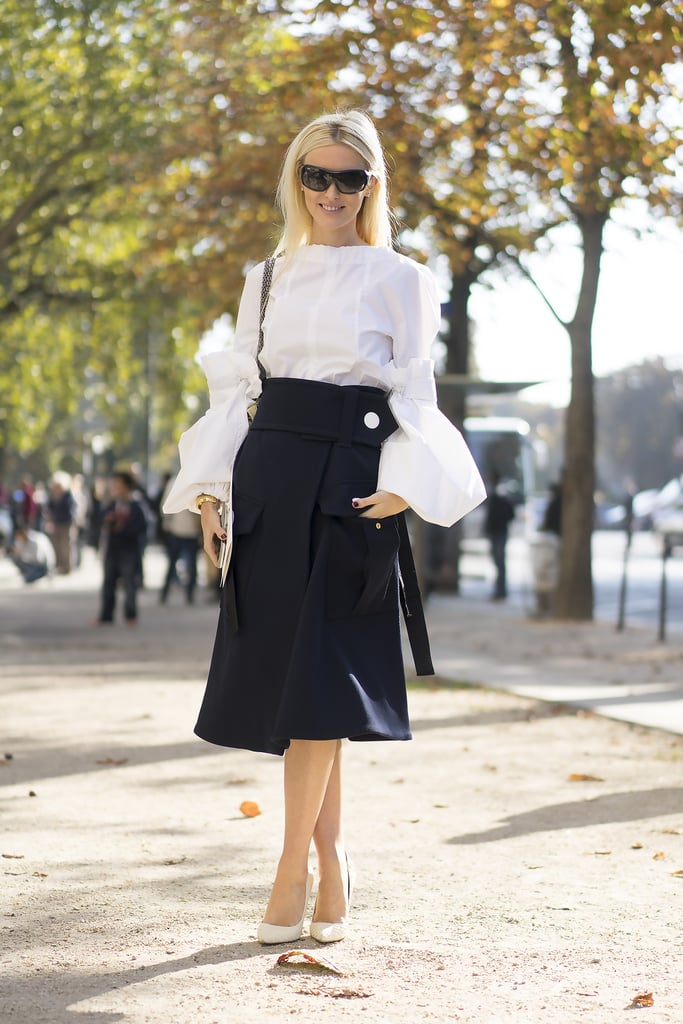 Keep it classic, but reinvent the skirt and top look with one of Fall's billowing statement blouses.