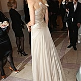 From the back, you can see the dress shows off a sleek satin crisscross design.