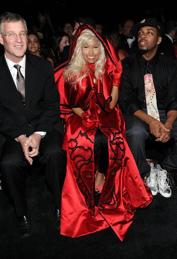 Nicki Minaj kept warm in her red cape.
