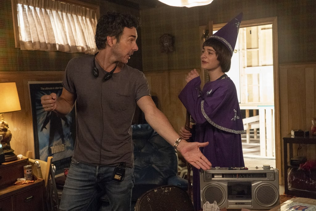 Noah Schnapp, dressed as Will the Wise, chats with Shawn Levy.