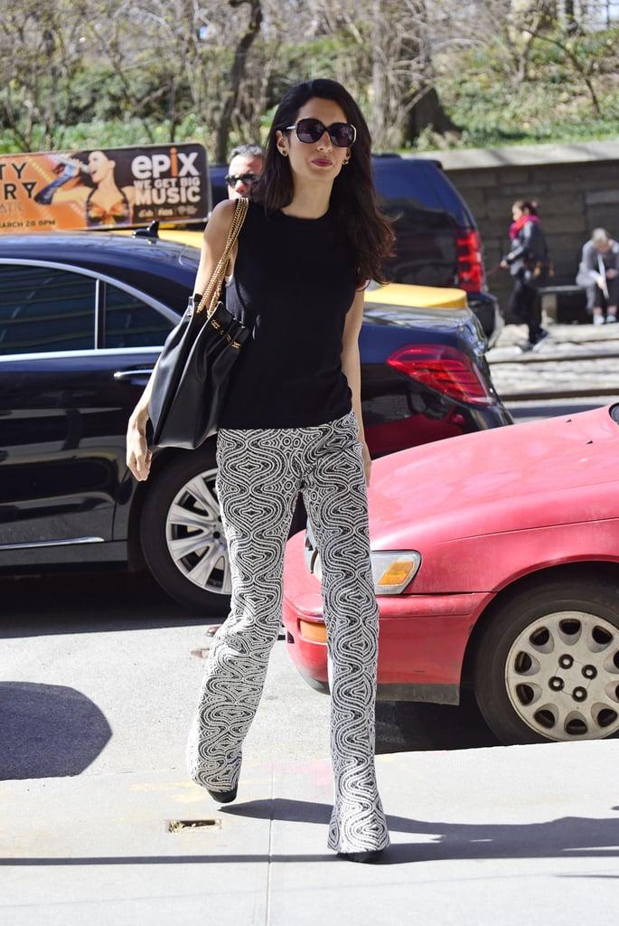 Wearing Giambattista Valli pants with a casual black tank and oversize sunglasses.