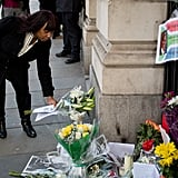 A woman added flowers to the memorial in London.