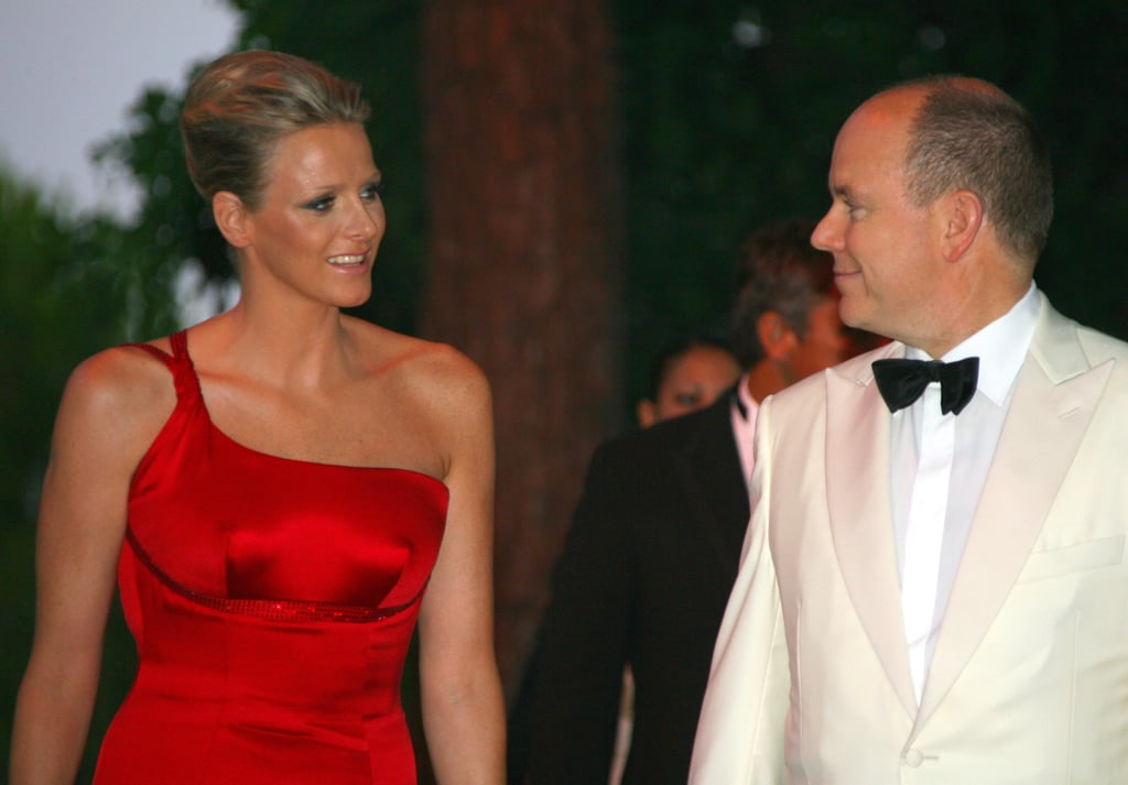 Wearing a red dress, Princess Charlene attended the Red Cross Gala in July 2009.  Source: Getty / Stephanie Danna/AFP