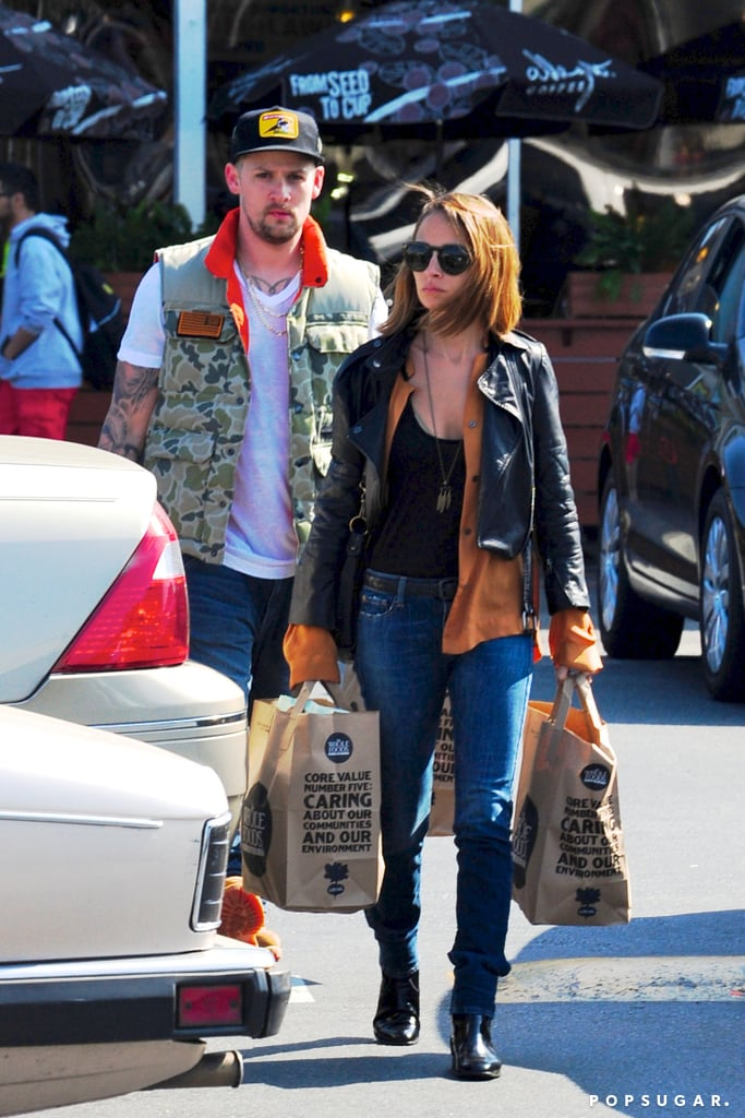 Nicole Richie and Joel Madden made their way through a grocery store parking lot on Thursday.