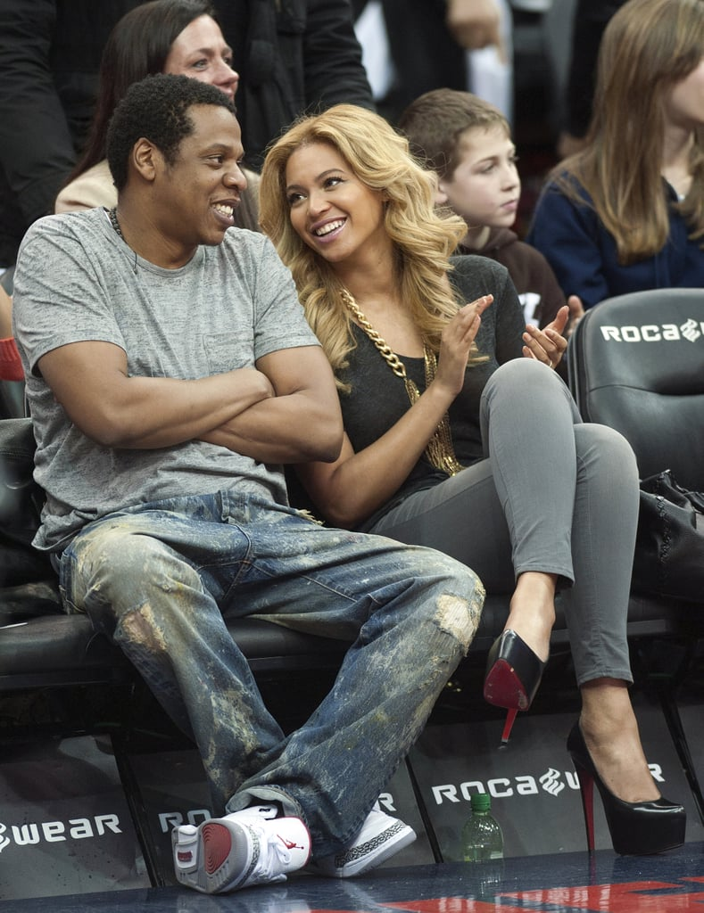 Jay-Z and Beyoncé Knowles Take the Floor For Their Team