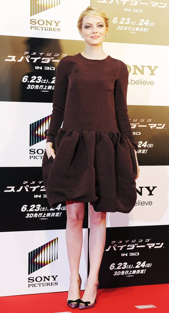 For the Tokyo world premiere, Emma chose a flouncy-hemmed drop-waist brown Rochas dress and glitter bow-tie Louboutin pumps.