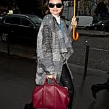 Miranda Kerr was all smiles in a preppy-cum-cool collared shirt and leather pants combo.