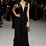 Nina Dobrev donned a sexy black gown with a plunging neckline to attend Elton John's Oscars viewing party in February 2012.