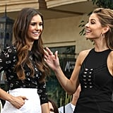 Nina Dobrev and Maria Menounos chatted in front of a crowd.