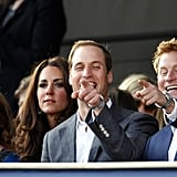 The pair pointed something out to Kate Middleton and their cousin Princess Beatrice during the Diamond Jubilee concert at Buckingham Palace in May 2012.