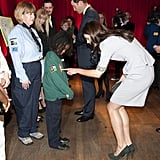 Kate took time to ask a little boy about his uniform as she and William took in a performance of African Cats in London in April 2012.