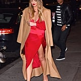 Chrissy chose a colorful wrap dress for her dinner date with John at Carbone Resturant in NYC. Meanwhile, John was casual in a stripe T-shirt and leather jacket.