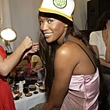 Naomi Campbell sported a trucker cap backstage in '02.