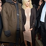 She Completed Her Look With T-Strap Sandals and a Brown Duster Coat