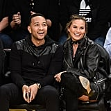 To attend a March basketball game in Los Angeles, Chrissy paired over-the-knee boots with a leather jacket.