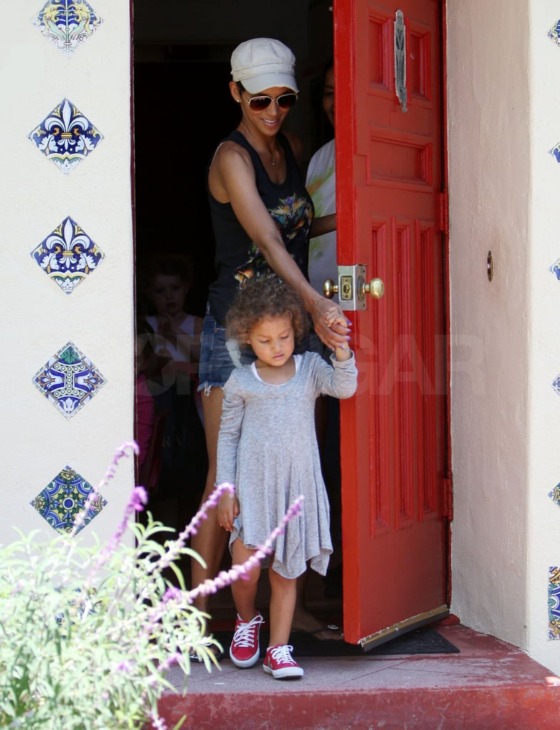 Halle Berry threw on a pair of short denim shorts and ventured out to pick up Nahla Aubry from preschool in LA yesterday. The girls have been hanging out close to home on the West Coast this Summer, enjoying afternoons at the park, mother-daughter walks on the beach, and visits from Olivier Martinez. It's been almost a year since Halle and Olivier first worked together on the South African set of Dark Tide. Halle's bikini body is featured in the film, and she's also currently snagged the top spot in this year's bikini bracket — don't forget to fill out your bikini bracket for a chance to win $1,000 from J.Crew!