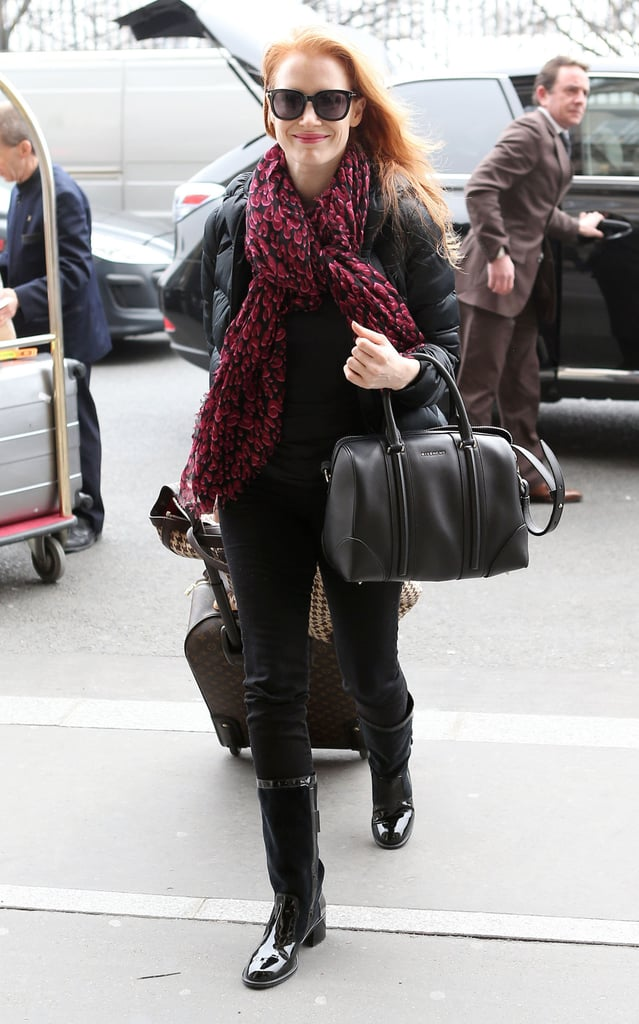 Jessica Chastain made a chic arrival in Paris wearing a red leopard Louis Vuitton scarf with her black Givenchy Lucrezia tote ($1,694).