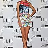 Poppy Delevigne showed off her stems in a standout print from Mary Katrantzou's Topshop collection.