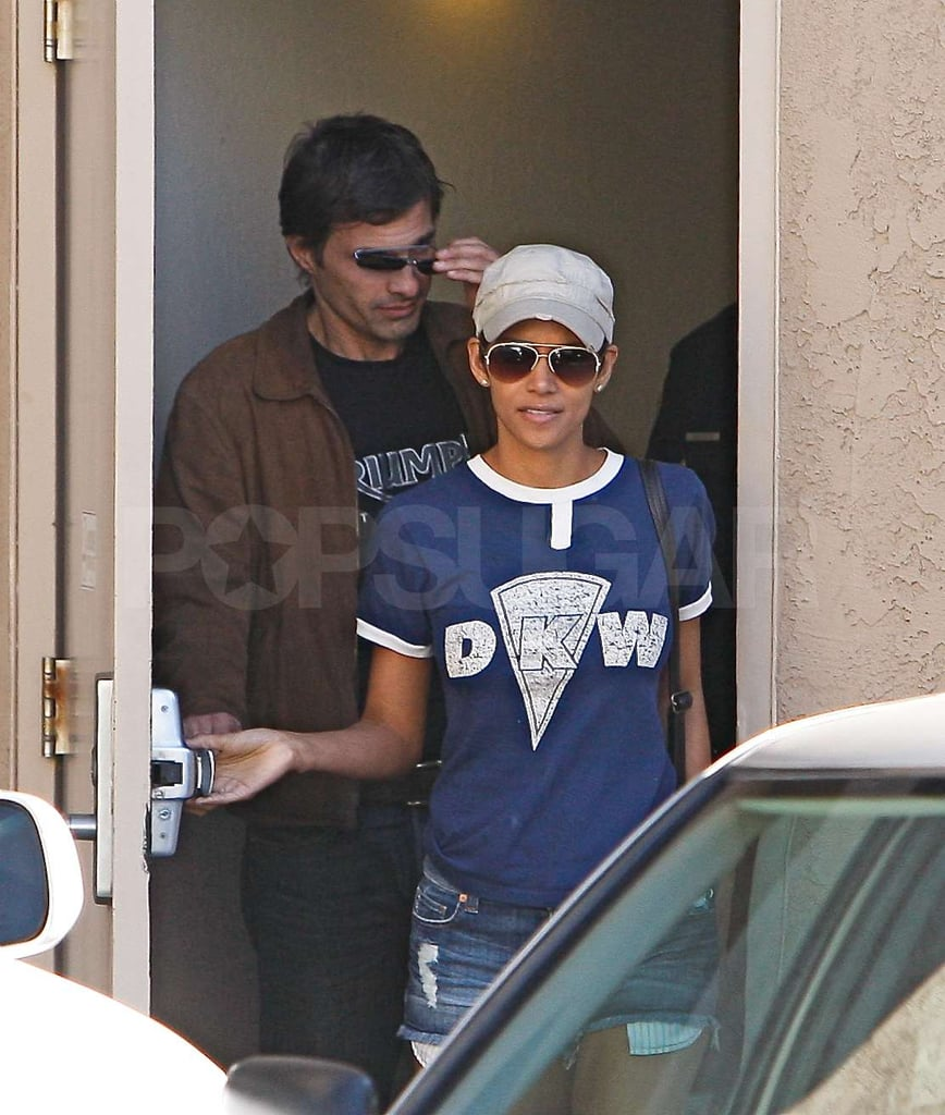 Halle Berry's denim cutoffs were so short her pockets were peeking out the bottom during a trip to a dentist's office in LA with Olivier Martinez yesterday. The actress has been taking care of important business this week, including checking out potential schools for Nahla in between romantic outings with Olivier. The happy couple has been enjoying each other's company at art shows and on his 45th birthday. Halle didn't score an Oscar nomination for her work in Frankie and Alice, though she will be there as a presenter during the big show. The past best actress winner could have more award season fodder added to her resume since Aretha Franklin is adamant that Halle should portray her in a biopic despite Berry's protests that she can't sing.