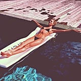 Candice Swanepoel relaxed on a raft during a day at the pool. Source: Instagram user angelcandices