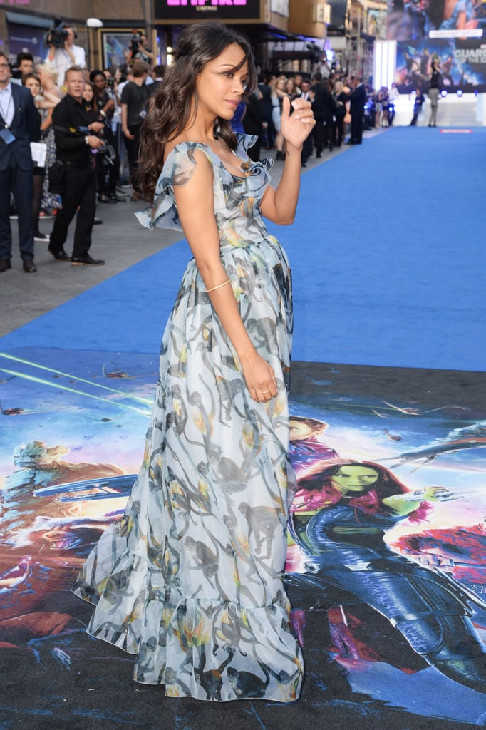 Zoe Saldana has yet to confirm or deny new reports that she is pregnant with twins, but she showed what looked like a small baby bump when she walked the carpet at the European premiere for Guardians of the Galaxy in a Valentino monkey gown in London on Thursday. The actress posed for pictures in a flowing blue dress and even stopped to sign autographs for gathered fans who had lined up outside the Empire Leicester Square. Zoe sparked chatter about a possible pregnancy earlier this week when she premiered Guardians of the Galaxy in LA while holding onto her stomach. She married artist Marco Perego in 2013 following a split from her Guardians costar Bradley Cooper.
