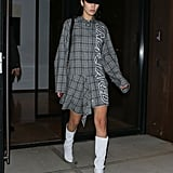 Bella Finished Off NYFW Wearing a Plaid Shirt Dress and White Boots