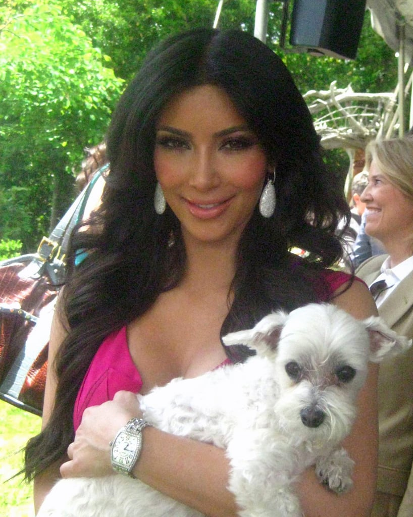 Kim Kardashian looks dazzling with Lucky by her side.