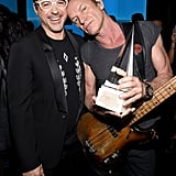 Pictured: Sting and Robert Downey Jr.