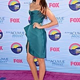 Nina Dobrev wore an aquamarine J Mendel dress, Jimmy Choo pumps, Kotur clutch, and Coomi jewelry.