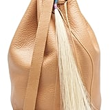 This Fredericks and Mae for Baggu ($180) drawstring tassel purse falls right in line with my Spring simplicity mantra. I love the simple bucket bag silhouette and chic camel hue. — Chi Diem Chau